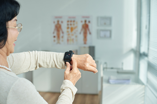 woman checking her watch on wearable device